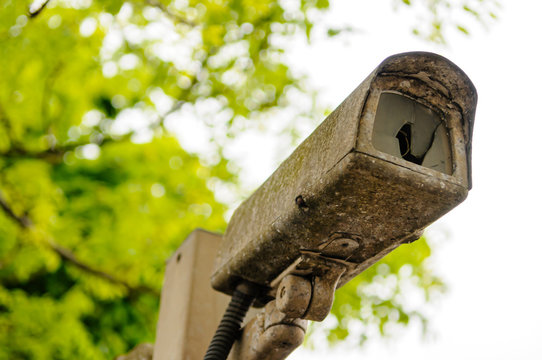 Broken, rusty old CCTV camera
