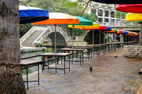 Empty downtown outdoor restaurant tables. Deserted restaurant and touristic destination due to corona virus pandemic. Stay-at-home-order issued by mayor.