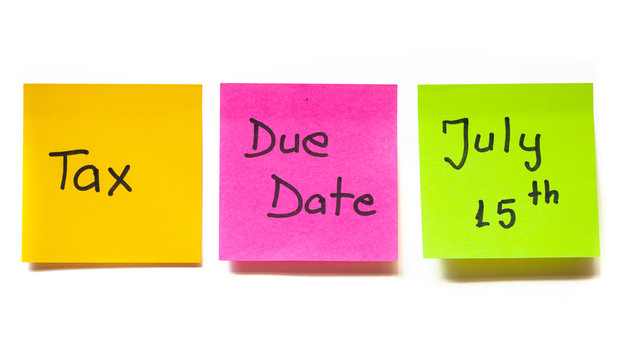 Tax due date postponed to July 15th concept with colorful sticky notes on white background. Government moved the filing date with three months, providing relief to contributors affected by covid-19.