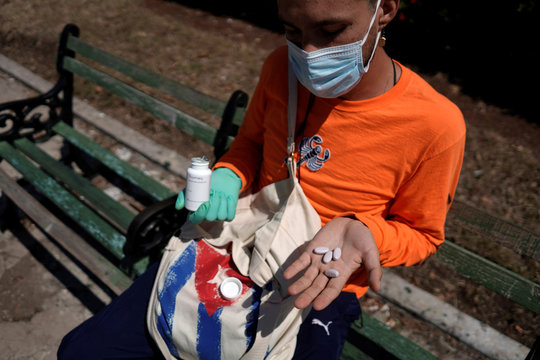 Oscar Berrios, a tourist from Chile, shows his remaining pills, as he is stranded in Cuba amid concerns of the spread of the coronavirus disease (COVID-19) outbreak, in Havana