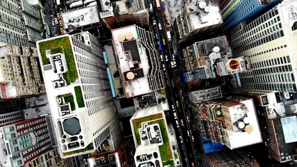 Fotomurales - Aerial view of New York downtown building roofs. Bird's eye view from helicopter of cityscape metropolis infrastructure, traffic cars moving on city streets and district avenues