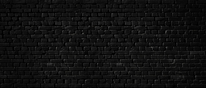 Texture of a black brick wall as a background or wallpaper