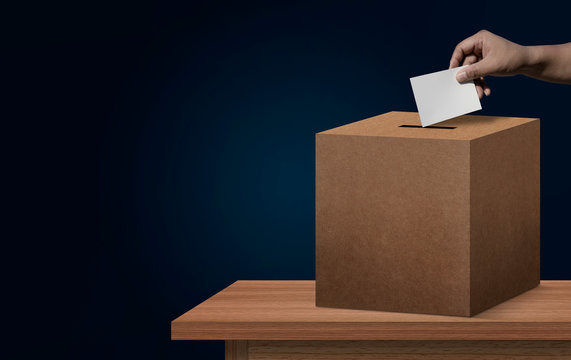 concept vote election Election of members of parliament, president, chief, executive. a ballot paper in hand isolated with clipping path on background.