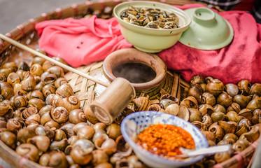 Boiled clams packaged in a popular food jar in Hanoi, Vietnam