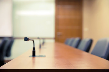Meeting room or boardroom with professional microphone on the table for auditorium, seminar and meeting concepts.