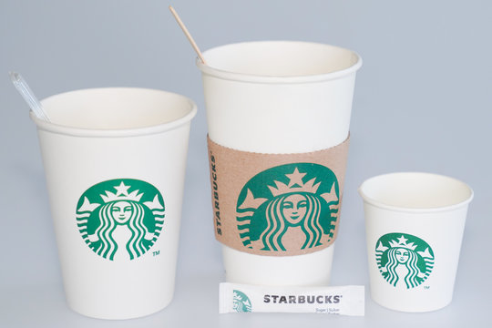 Starbucks coffee logo sign on coffee container to take away different size cafe