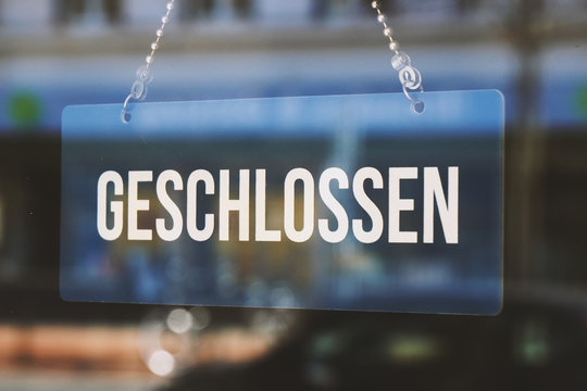 sign geschlossen - closed in german - economy crisis or business closure concept