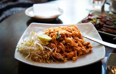 thai food pad thai serviced on a plate
