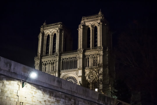 Notre Dame de Paris cathedral at night .