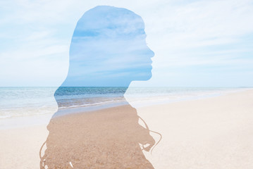 Double exposure with silhouette of woman and sea landscape. Concept of psychological health Wall mural
