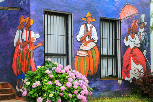 COLONIA, URUGUAY - DECEMBER 8: Painted facade of Visual Artists Association building on December 8, 2014 in Colonia del Sacramento, Uruguay. Colonia del Sacramento is one of the oldest towns in Urugua