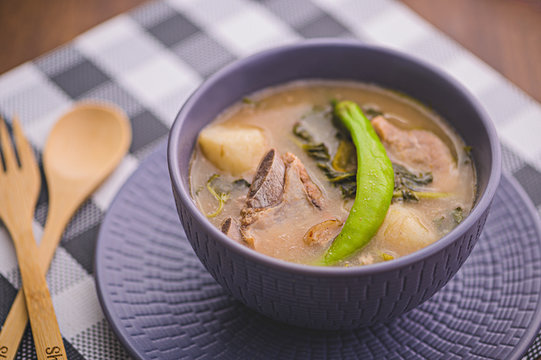 Sinigang is a Filipino dish famous for its sour and sometimes spicy broth. Typically, it's tamarind base mixed with leafy vegetables, meat or fish.