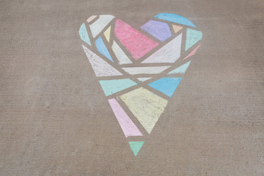 Geometric heart created with sidewalk chalk and painter's tape