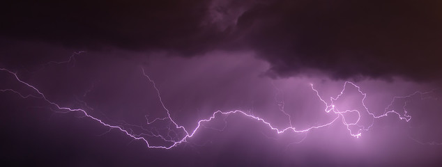 Night sky with various lightning in natural colors.