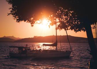 Fototapete - Beautiful bright landscape, sunset on the seashore and boats in the port, Mediterranean Sea Turkey