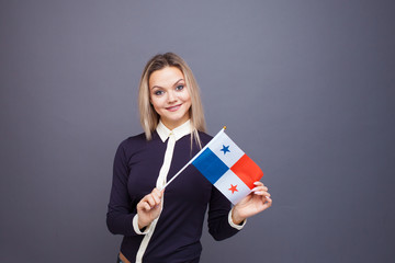 Immigration and the study of foreign languages, concept. A young smiling woman with a Panama flag in her hand