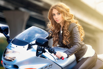 young woman on a motorcycle Wall mural