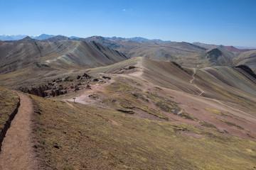 Lush green and red valleys around the Palccoyo Rainbow Mountains, Peru