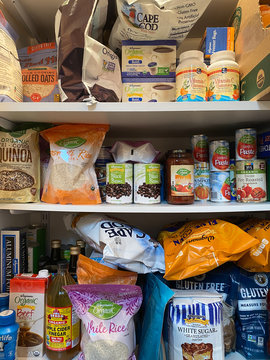 WOODBRIDGE, NEW JERSEY / USA - March 28, 2020: Dried and shelf stable food items are stored in a residential pantry, in preparation for potential Coronavirus quarantine in this illustrative editorial