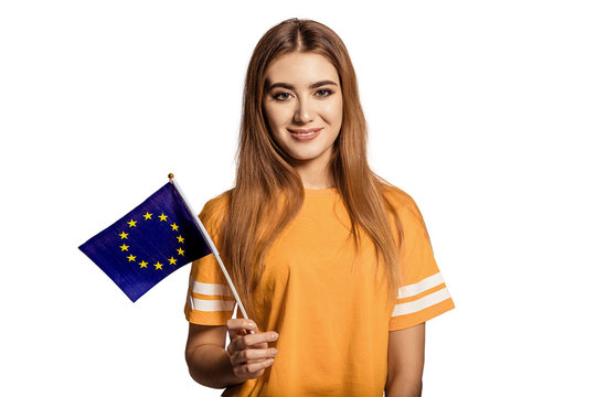 Young female student holds hand European flag. It symbolises both the European Union and the identity and unity of Europe. White background, isolated.