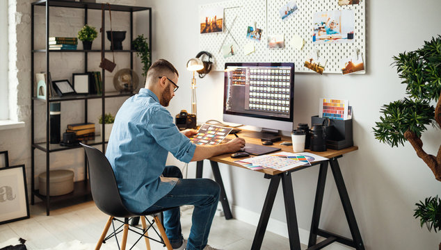 Modern designer working in home office