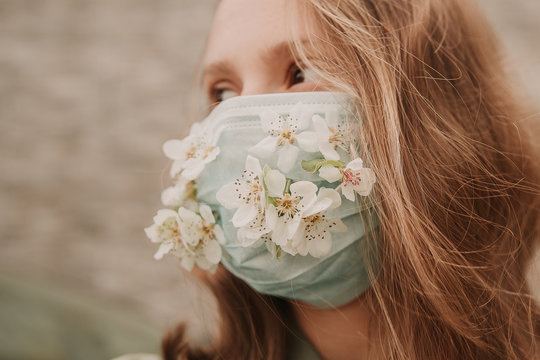 girl in mask with flowers