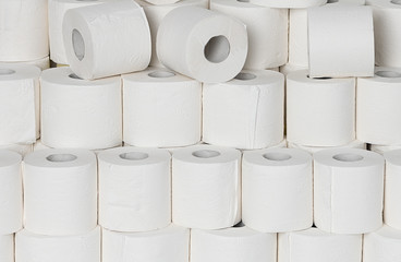 Toilet paper rools stacked on top of each other