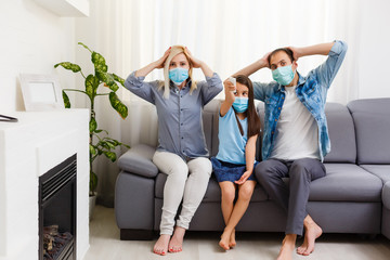 family On The Sofa Watching tv at home. Stay at home during quarantine