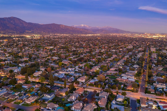 Aerial night view of the  Arcadia area with the white snowy Mt. Baldy
