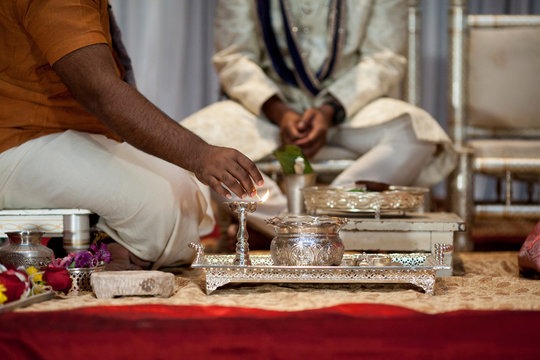 Detail shot of lighting of flame in Indian Hindu wedding.
