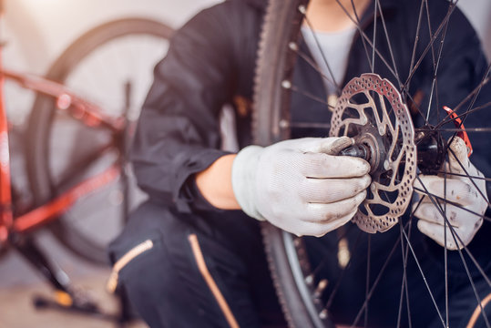 Bicycle maintenance, Rider is assembling the bicycle parts, Close-up.