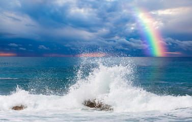 Wall Mural - Storm on the sea with amazing rainbow