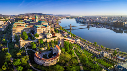 Budapest, Hungary - Aerial panoramic skyline view of Buda Castle Royal Palace with Szechenyi Chain Bridge, St.Stephen's Basilica, Hungarian Parliament and Matthias Church at sunrise with blue sky Wall mural