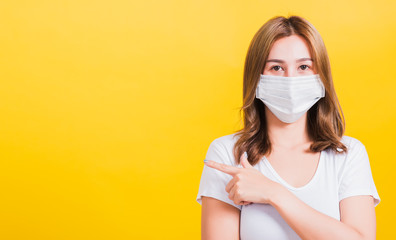 woman wearing face mask protects filter dust pm2.5 anti-pollution, anti-smog, and air pollution her pointing out to side