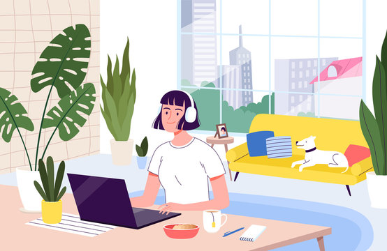 Young woman freelancer works remotely from her apartment. The concept of distant work during the quarantine and isolation of coronavirus