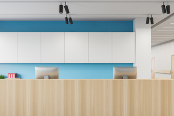 Reception desk in white and blue hospital close up