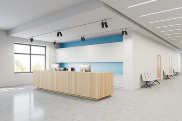 Reception and chairs in white blue hospital lobby Fotomurales