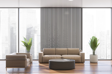 Gray office waiting room with leather sofa