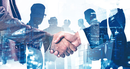Handshake in Moscow city, business partnership