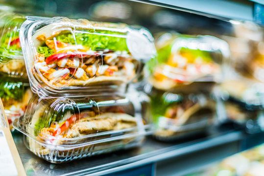Chicken with pita sandwiches in a commercial refrigerator