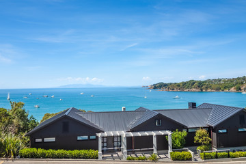 Oneroa Bay and village, the main township and the most popular beach in Waiheke Island, New Zealand.