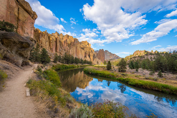 River flowing in the valley against the background of sharp rocks. Smith Rock state park, Oregon Wall mural