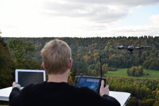 black flying drone in sky