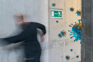 Corona Virus concept: Unidentifiable person running and fleeing towards emergency exit with corona virus renderings in a newly errected building with concrete walls Wall mural