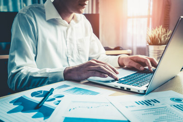 Businessman accountant or financial expert analyze business report graph and finance chart at corporate office. Concept of finance economy, banking business and stock market research.