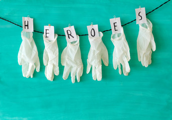 """Giiving respect to the health care system, symbol picture,medical gloves and the message """"Heroes"""",covid-19, corona virus"""