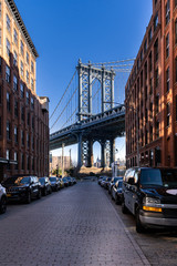 Wall Mural - Down Under the Manhattan Bridge Overpass - DUMBO Point from brooklyn New york city NY USA. This is the neighborhood landmark located between manhattan and brookltn bridge in New York City USA.