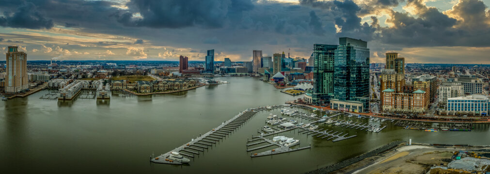 Aerial view of stormy sky over the Inner Harbor of Baltimore Maryland with sky scrapers and sailboats