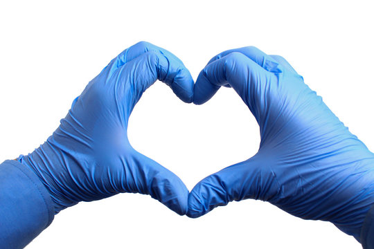 Hands in medical gloves depict a heart on a white background, isolated. Recovery concept