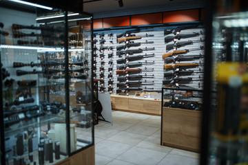 Rifle choice, showcase in gun shop, nobody Fotobehang